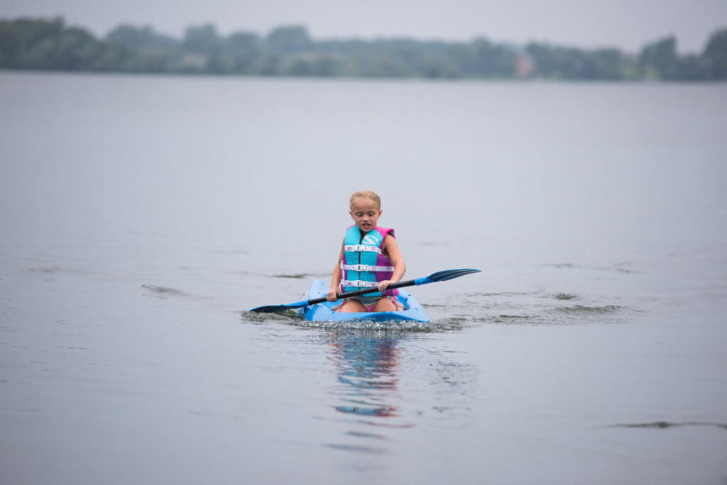 Kids paddle boarding at Barrett Lake Resort and Campground Cabin Rental