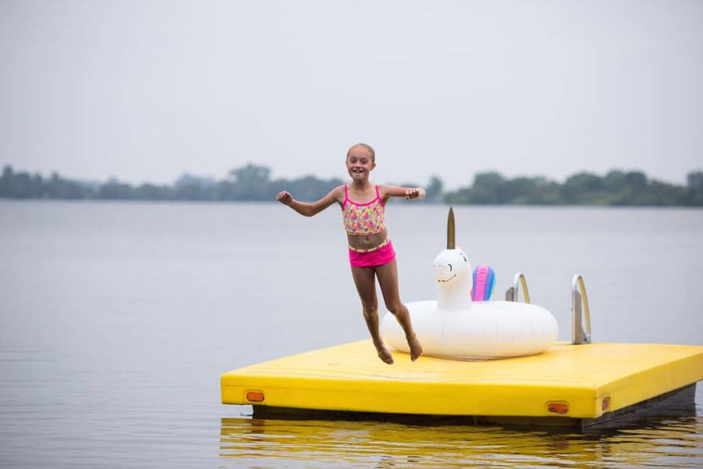 Young girl jumping into Barrett Lake