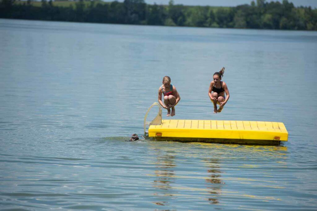 Kids swimming at Barrett Lake Resort and Campground Cabin Rental