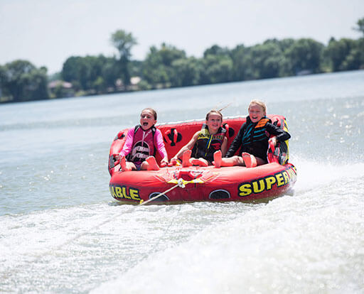 Kids tubing on Barrett Lake